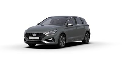 Front side view of the new Hyundai i30 in the colour Olivine Grey.