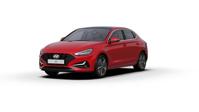 Front side view of the new Hyundai i30 Fastback in the colour Engine Red.