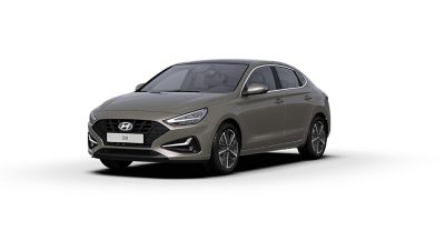Front side view of the new Hyundai i30 Fastback in the colour Silky Bronze.