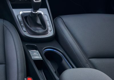 The new ambient light technology in the centre console and footwell of the new Hyundai Kona Hybrid.