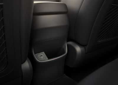 The rear USB port comforting the heated backseats in the new Hyundai Kona Hybrid compact SUV.